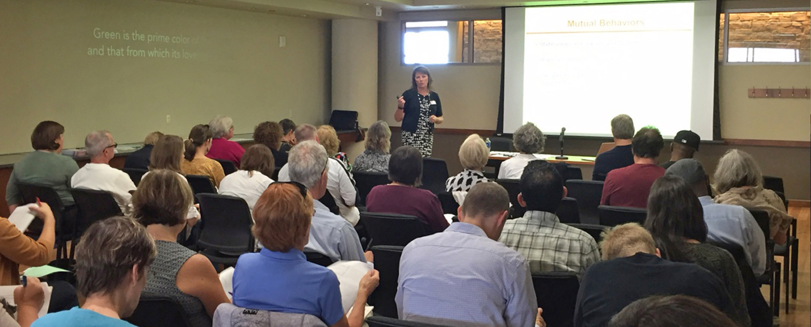 Sherry speaking at a session.