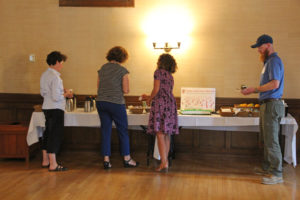 book club participants taking a break at the food table