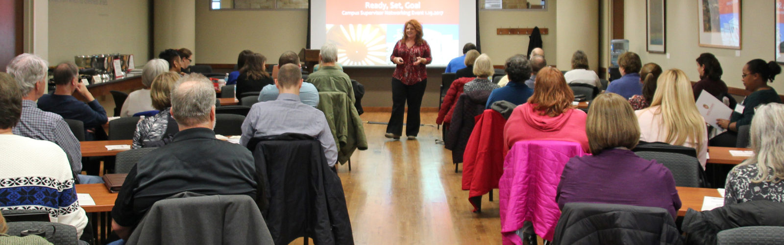 Shelly speaking at a session.